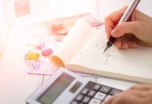 calculator, pen and paper