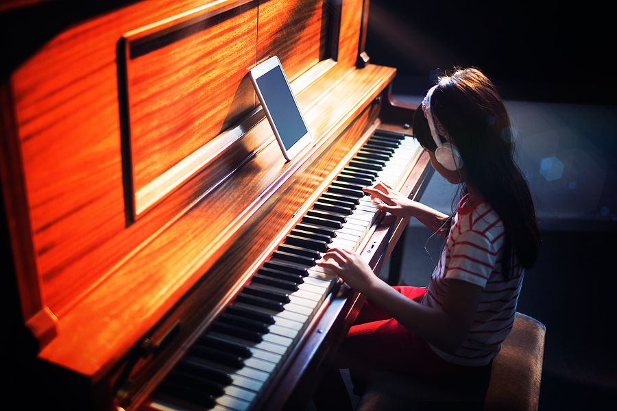 Oclef Student at Piano lesson